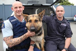 Constable Darren Pavelka, Police dog Brock and his handler Senior Constable Lyal Bayliss. Photo / Star