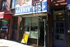 Ilyusha's Barber Shop in Harlem, New York. Photo / Jack Tame