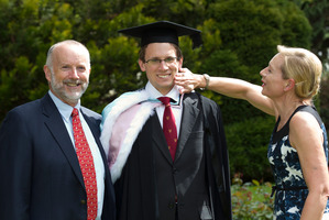 Law graduate Benedict Tompkins with parents Arthur Tompkins and Mary Clark. Photo / Brett Phibbs
