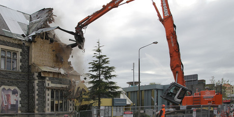 Demolition of the earthquake damaged Cranmer Courts. Photo / Geoff Sloan