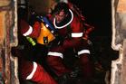 Salvage diver Vinnie Esposito works inside the sunken MV Rena yesterday.  Photo / Alan Gibson