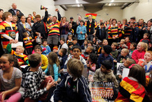 Supporters squeeze into a warm-up room to get a glimpse of the Ranfurly Shield. Photo / Christine Cornege