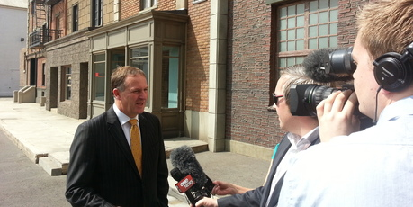 John Key talks to media during his visit to Hollywood. Photo / Jack Tame