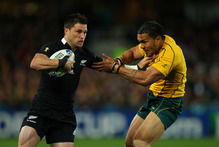 Cory Jane of the All Blacks hands off Digby Ioane of the Wallabies. Photo / Getty Images