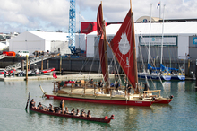 People celebrate the departure of Waka Tapu from the Viaduct Events Centre, Auckland. Photo / Steven McNicholl