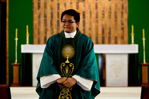 Father Larry Rustia says having different ethnicities celebrating Mass has helped the Catholic Church remain relevant among its migrant communities. Photo / Dean Purcell
