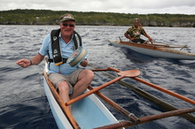 Master canoe-maker Taumafai Fuhiniu keeps a watchful eye on the writer's canoe skills. Photo / Geoff Thomas