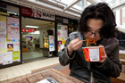 Peter Kim, 22, says S-mart's noodles are not only cheap, but he likes his lunches hot. Photo / Greg Bowker