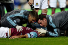 West Ham United's Winston Reid lies on the ground as he is attended to by medics, as his team plays Queens Park Rangers during their English Premier League soccer match. Photo / AP
