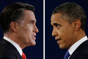 Republican presidential nominee Mitt Romney and President Barack Obama speak during the first presidential debate at the University of Denver. Photo / AP