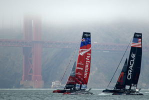 Team NZ, left, and Oracle Team USA practice on San Francisco Bay Photo / AP