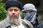 Muslim cleric Abu Hamza al-Masri, with a masked bodyguard. File Photo / AP