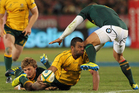 Australia's Kurtley Beale is tackled by South Africa's Patrick Lambie. Photo / AP
