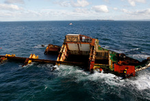 The engineering nightmare that is the salvage of the wrecked MV Rena hasn't become any easier in the months since the container ship slammed into the Astrolabe Reef off the Tauranga coastline on this date last year. Photo / Christine Cornege
