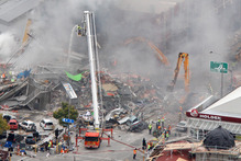 Emergency service staff hunting for survivors amongst the rubble of the CTV Building. Photo / Mark Mitchell