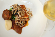 The 'plate of pig' with savoy cabbage and turnip cream. Photo / Chris Gorman