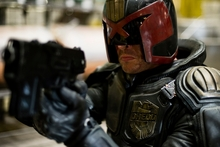 Karl Urban's Judge Dredd keeps his helmet on throughout the entire film. Photo / Supplied