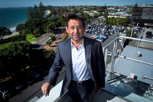 Takapuna resident John Copson plans a multi-storey retail and apartment block extending 100m back from Hurstmere Rd to present a big glassy face to the beach and the public reserve. Photo / Natalie Slade