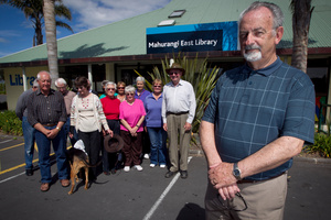 Laurie Webb was pleased to hear the announcement by Len Brown (left) that the library will stay open. Photo /  Natalie Slade