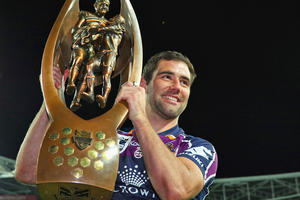 Cameron Smith holds up the premiership trophy after Melbourne beat Canterbury 14-4 in the NRL final. Photo / Getty Images