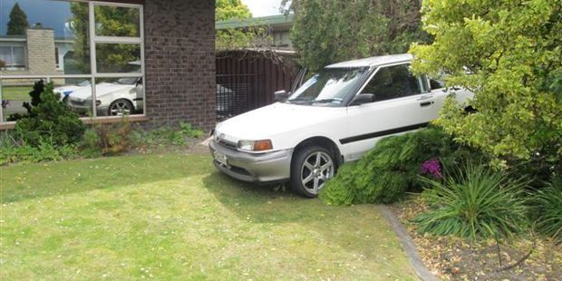 A driver and his passenger had a lucky escape when their car smashed through the front fence of a Pirimai, Napier, home. Photo / Supplied