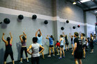 CrossFit gyms pride themselves on devising fresh training methods like throwing weighted bags against a wall. Photo / Supplied