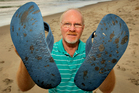 Rusty Kane, from New Plymouth, visited Papamoa Beach yesterday and found oil smeared across the bottom of his jandals. Photo / Alan Gibson