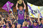 Todd Lowrie of the Storm celebrates with the NRL trophy. Photo / Getty Images