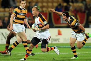 Matt Vant Leven of Waikato evades the tackle of Jayden Hayward of Taranaki. Photo / Getty Images