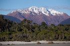 The snow capped Red Hills seen from Big Bay, Southwest land.