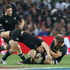 Dan Carter is tackled by Duane Vermeulen.Photo / Getty Images