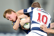 Hayden Parker of Otago and Gareth Anscombe of Auckland tussle for the ball. Photo / Getty Images