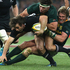 Conrad Smith is tackled by Marcell Coetzee and Jean de Villiers.Photo / Getty Images