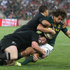 South Africa's Zane Kirchner is tackled by Andrew Hore and Aaron Smith.Photo / Getty Images