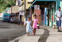 Girls wearing their Sunday best, heading to Scared Heart church. Photo / Kelly Lynch