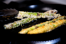 Cornmeal crumbed asparagus cooked over high heat, turned frequently, until they turn golden. Photo / Babiche Martens