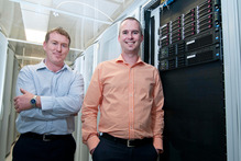 Hamish Roy (right) and John Ward of IT company vBridge have seen their business grow since the earthquakes. Photo / David Alexander