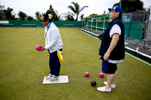 Poa Mafileo (in white) aims for the jack as Lorraine Beazley looks on at the Grey Lynn Bowling Club. Photo / Dean Purcell