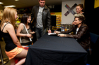 US singer Adam Lambert signs CDs for hundreds of fans at JB Hi Fi on Queen Street Wednesday. Photo / Dean Purcell