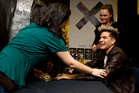 US singer Adam Lambert signs CDs for hundreds of fans at JB Hi Fi, on Queen Street, today. Photo / Dean Purcell