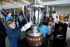 Cam Fitzgerald-Little, 11, touches the Bledisloe Cup. Picture / Mark Mitchell