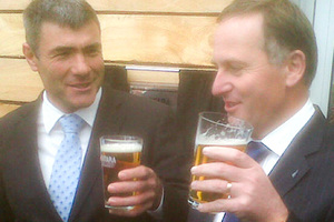 National MP Nathan Guy and John Key share a beer in Paraparaumu. Photo / APN