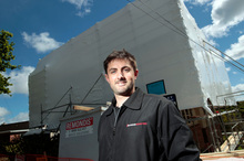Chris Ramsey at one of the buildings his company has shrinkwrapped. Photo / Michael Craig