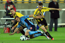 Mitchell Mallia of Sydney FC is tackled by Louis Fenton and Tony Lochhead of the Phoenix during Saturday's match. Photo / Getty Images