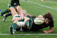 Sam Whitelock dives over the line for a try in the All Blacks' 32-16 win over the Springboks. Photo / Getty Images