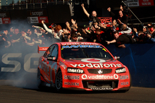 TeamVodafone Holden driver Jamie Whincup celebrates his fourth Bathurst victory yesterday with a burnout. Photo / Getty Images