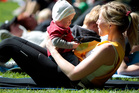 Mum Rachel Grunwell sweats it out at boot camp while son Finn supervises. Photo / Michael Craig