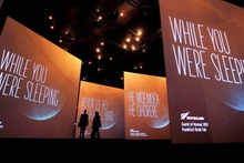Video screens are seen in the New Zealand pavilion at the Frankfurt Book Fair, where New Zealand is this year's Guest of Honour. Photo / AP
