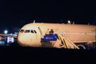 The Syrian passenger plane that was forced by Turkish jets to land at Esenboga airport in Ankara, Turkey. Photo / AP