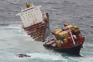 The container ship Rena sits in two pieces on Astrolabe Reef off the coast of Tauranga. Photo / Joel Ford
